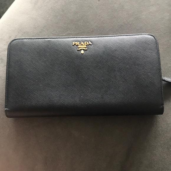 f22810a8e61 Authentic Prada wallet with snap buttons   zipper.  M 5b1d5b3b1b3294e77b249184